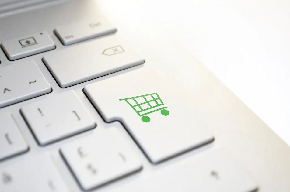 keyboard Enter button with a shopping cart image on it