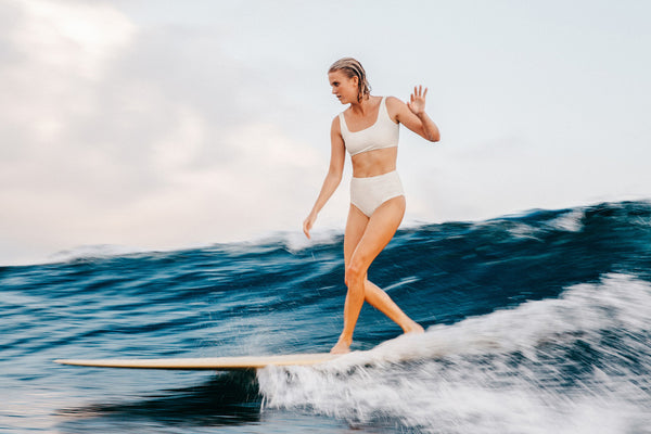 female surfer sustainable bikini single fin