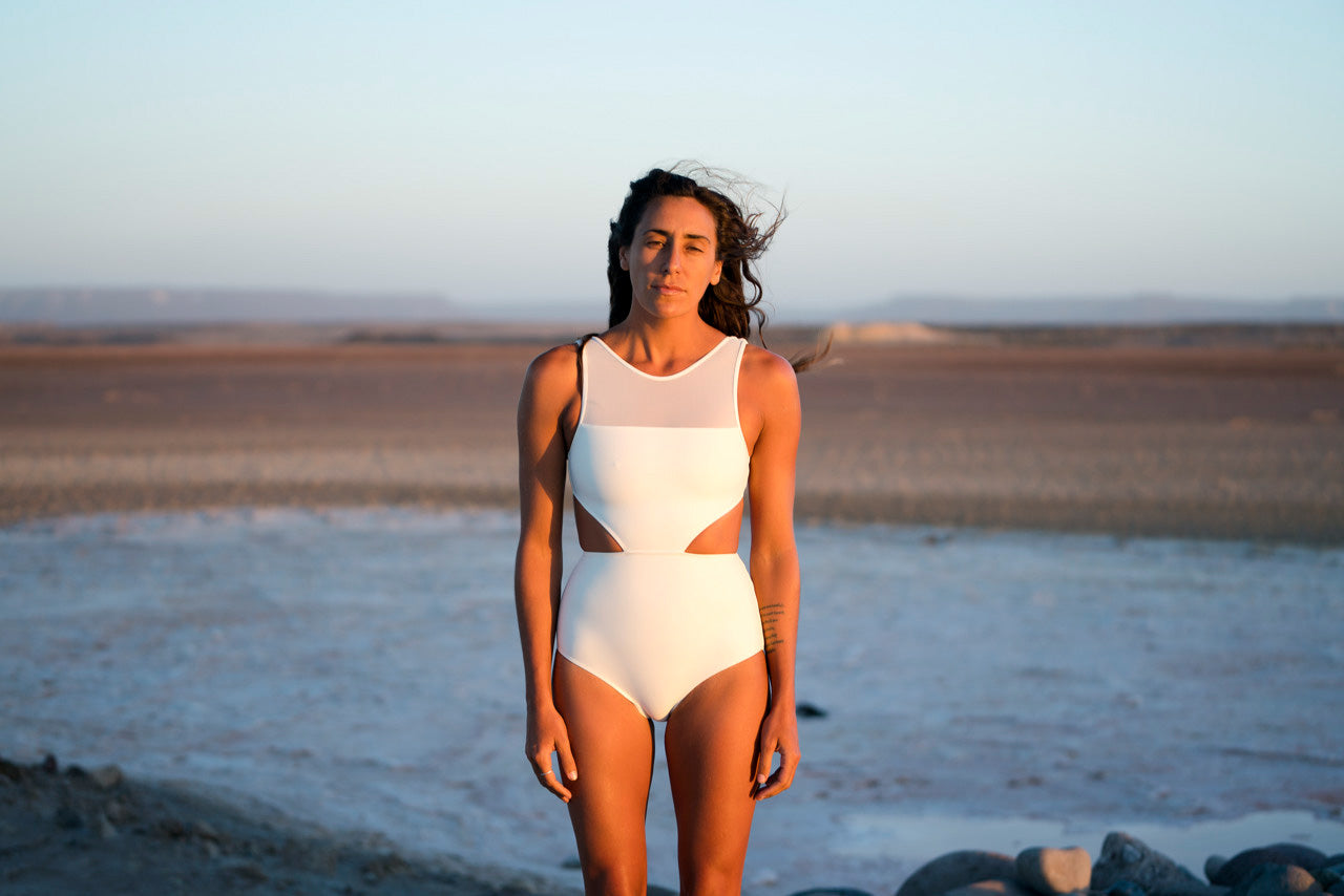 Surfer longboarder sustainable swimsuit bathingsuit september line beach