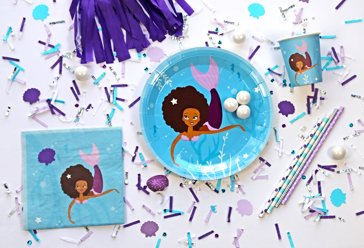 mermaid party supplies on table