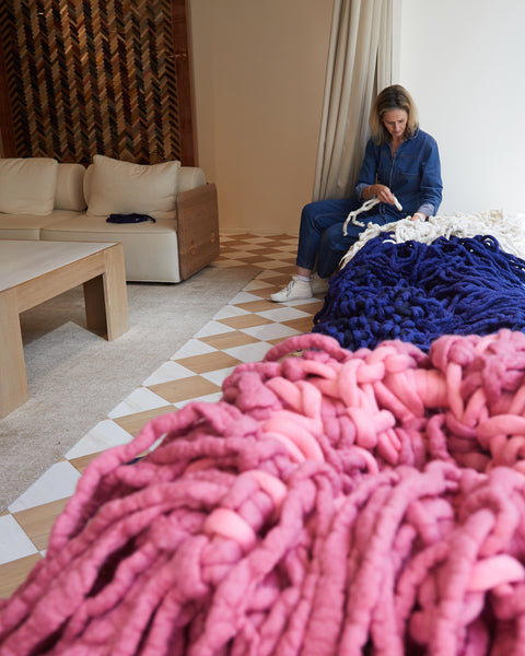 Jacqui Fink working on an art installation in store at Gabriela Hearst, New York