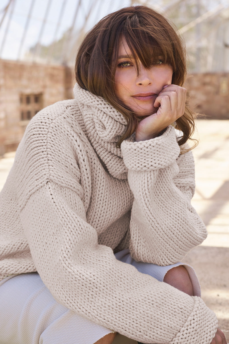 Lifestyle shot of model wearing the Ingrid sweater knitted in Meadow from The #Knitwell Collection. Meadow is a super chunky ethical and sustainable yarn made from Australian Merino Wool.