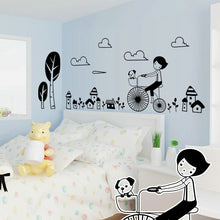 Child riding a bicycle through town wall decal for children - wall decals home decor