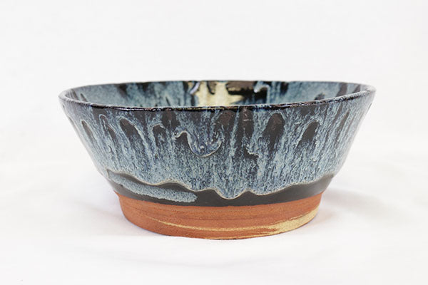 Blue and Black Bowl on Terracotta