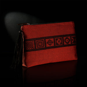 Loom% | handwoven Cinnamon envelope bag with black woven band.