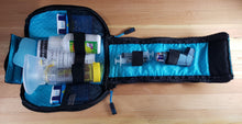 interior of insulated medical bag showing how it can hold medicine, instructions and epinephrine.