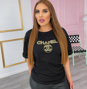 Black top with gold rhinestone letters
