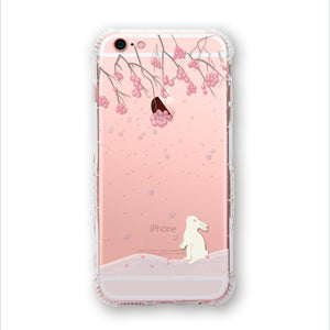 Fallen flowers in the snow phone case