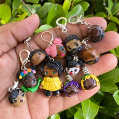 A handful of polymer clay stitch markers