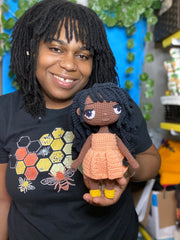 Whitney, Holding a crochet doll