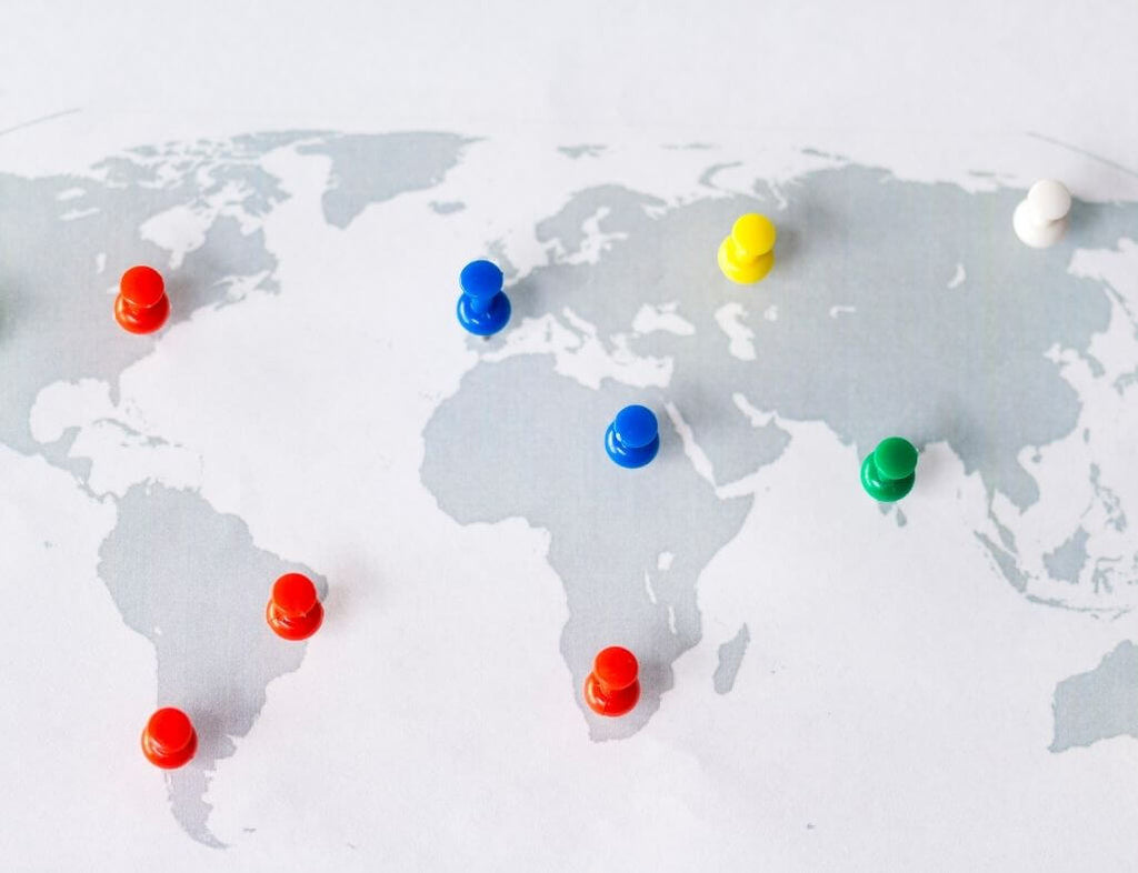 Different color pins on different regions on a world map