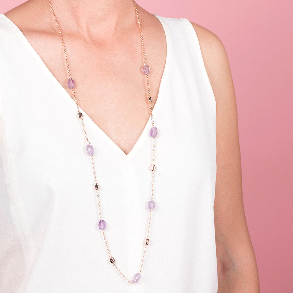 worn amethyst stone necklace