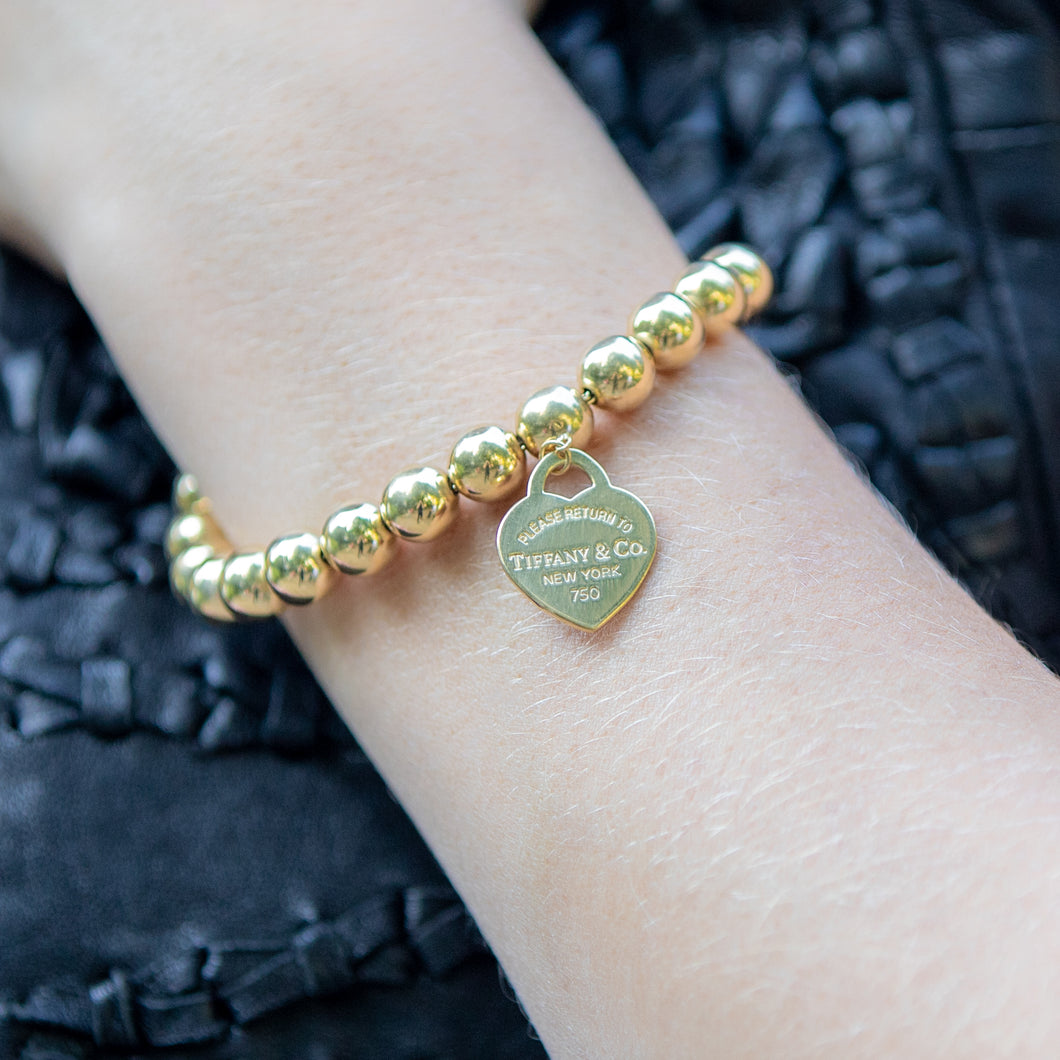 Gold Tiffany & Co Ball Bracelet with Heart Charm