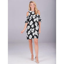 "Mud Pie Cora Cold Shoulder Dress - 100% rayon dress features cut-out shoulder detail, flounce ruffle at sleeves and keyhole back with mother of pearl button closure. Measures approximately 34 1/2"" from shoulder to hem on size small."