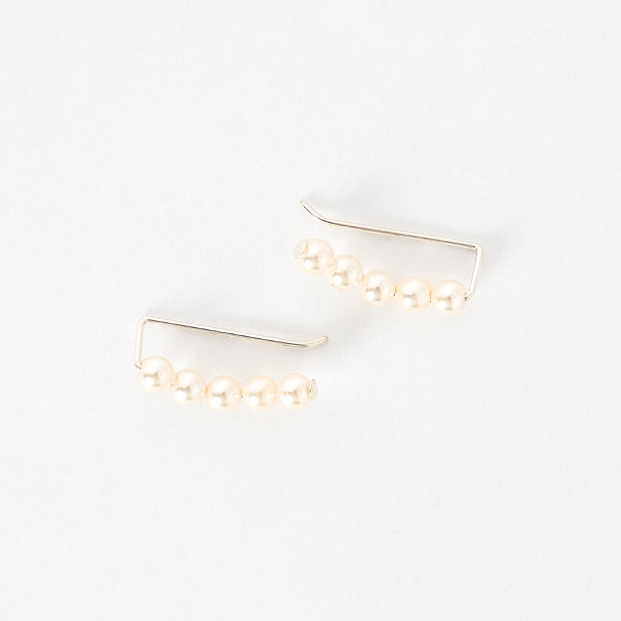 top view of the ivory pearl ear climbers - handmade in maine - jewelry - elegant earrings