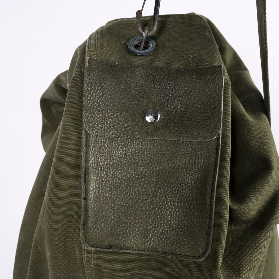green leather pocket on the US army duffle - detail shot - up close image - vintage product