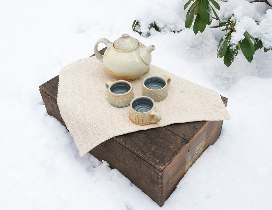 vintage placemat lifestyle shot - tea setting - cozy winter vibes - espresso mugs