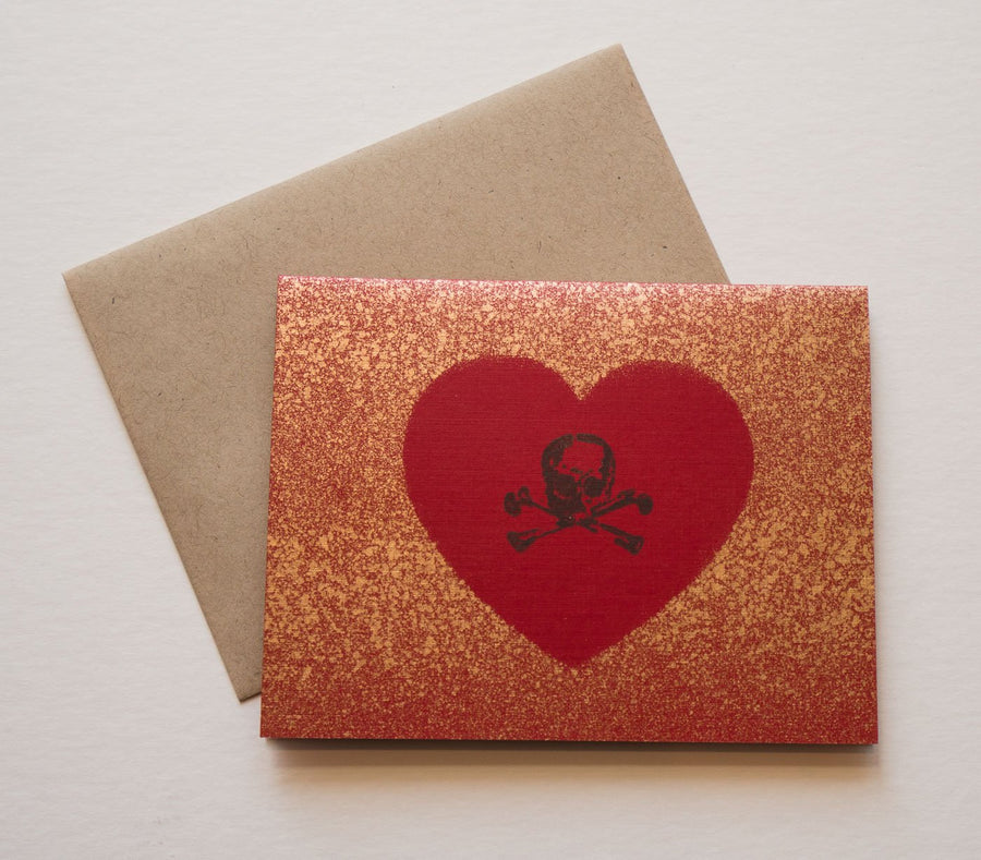 Skull and Crossbones on Heart with Splattered Gold