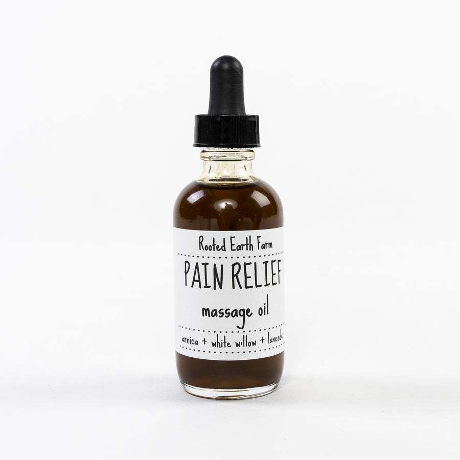 pain relief massage oil handmade in maine by rooted earth apothecary