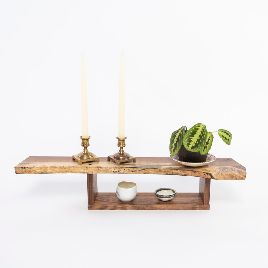 solid walnut wall shelf - hand carved - live-edge - hand beveled edges - lifestyle shot