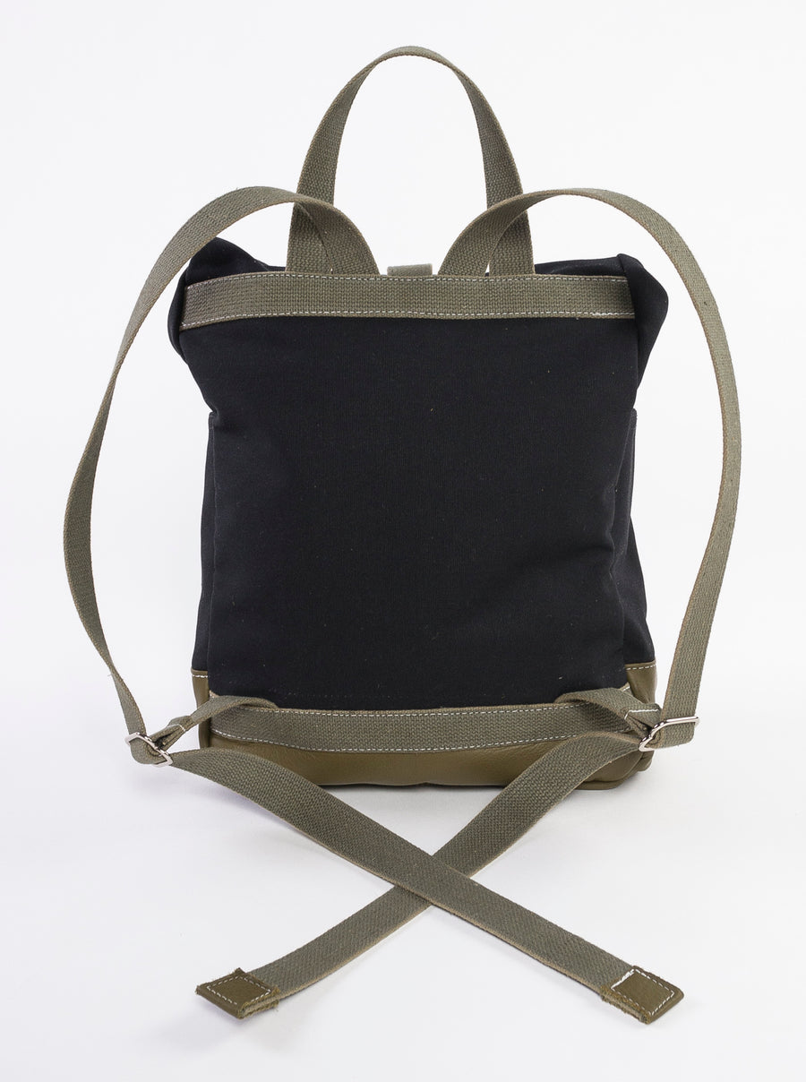 The Field Backpack made at Venn + Maker - back view - black canvas - olive green straps - leather base - travel bag