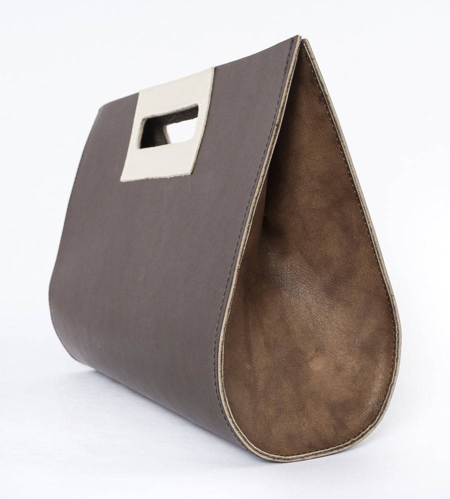sideview of the leather medium teardrop bag - brown and white leather - women's fashion