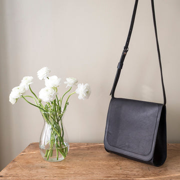 the bloomsbury saddle bag - styled shot - black leather purse - hand stitched