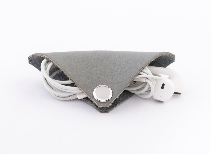 The Earbud Cord Keeper - Finally a no tangle way to keep your earbuds stored in your pocket or bag.