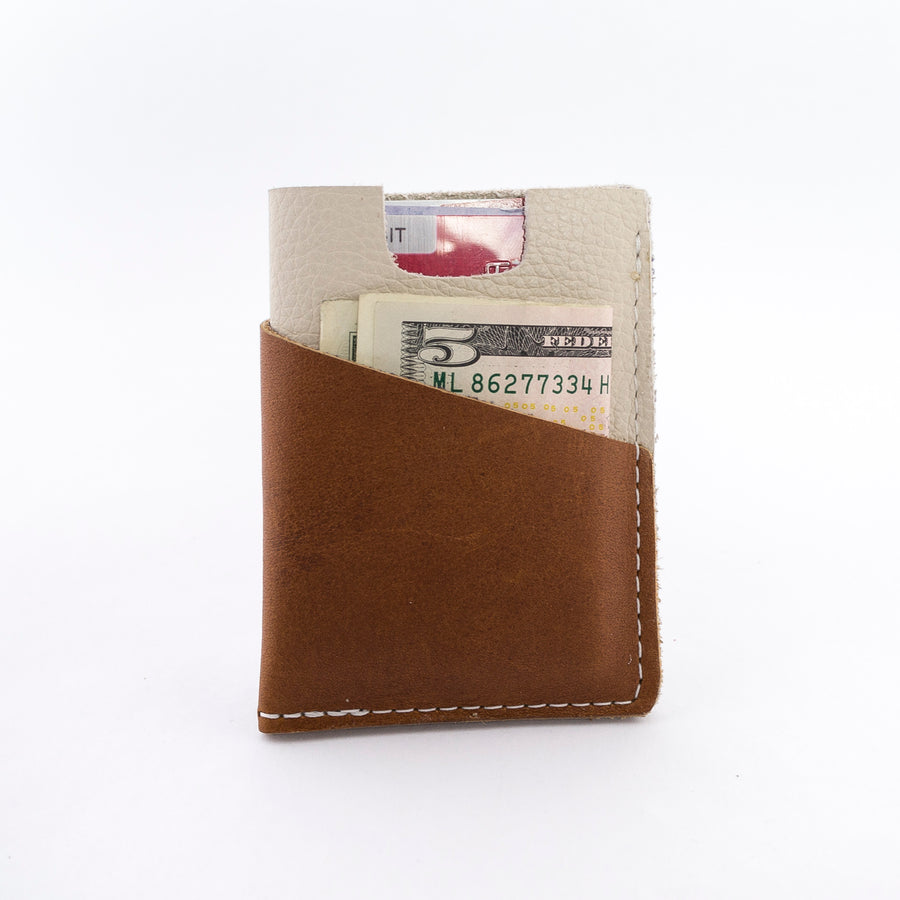 the brockman wallet with cash and cards - styled shot - in use