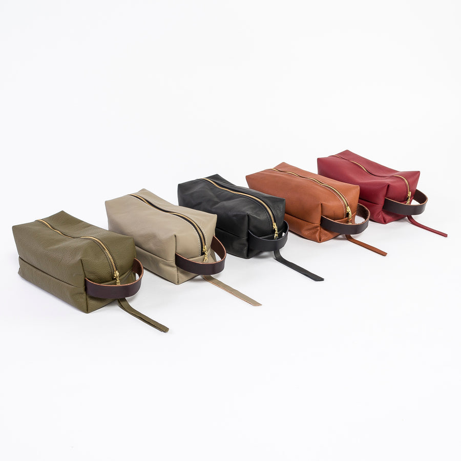Leather dopp kit collection shot - 5 colors - durable leather - handmade in workshop at venn + maker