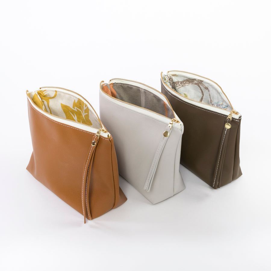 the faux leather travel pouch - toiletry bag