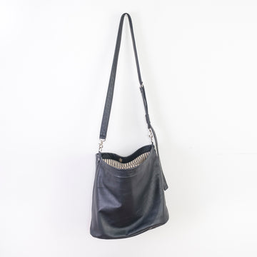 cross-body bag is a relaxed hobo design featuring a soft, slouchy, silhouette with enough room for storing everyday items