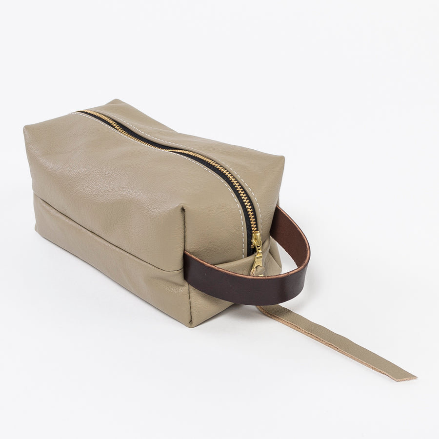 sand leather dopp kit - workshop at venn + maker - handmade in house - durable design - cosmetic bag - brown leather handle