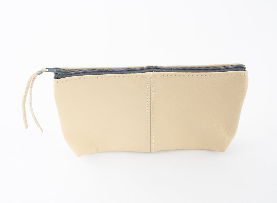 Our handmade leather pouch is perfect for storing accessories in a bigger bag.