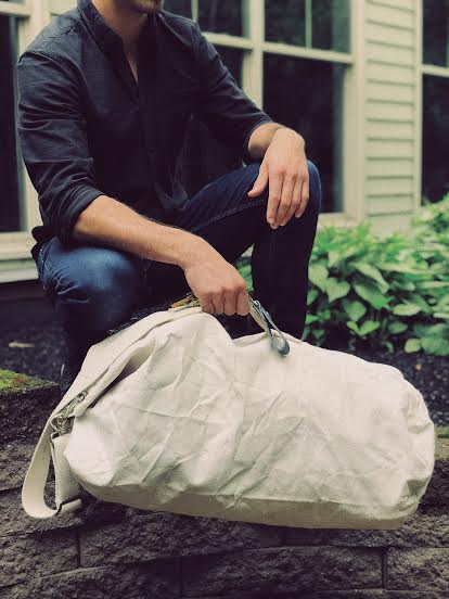 lifestyle image of the vintage navy duffle - World War 2 travel bag - French - sourced in Maine