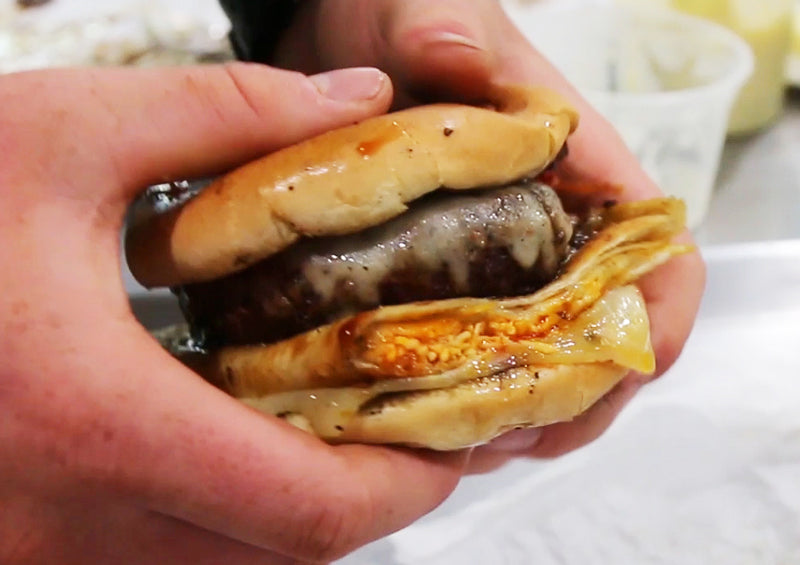 Quesadilla burger being held