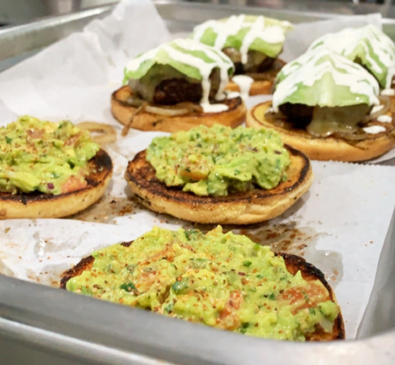 Siesta burger opened with guacamole on bun