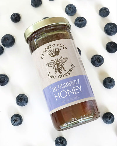 Classic City Blueberry Honey with Blueberries around jar