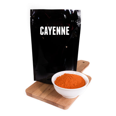 Large bag of Cayenne with bowl of spice
