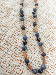 Obsidian, Lava Rock , Hazelwood + Raw Cherry Baltic Amber Teething Necklace