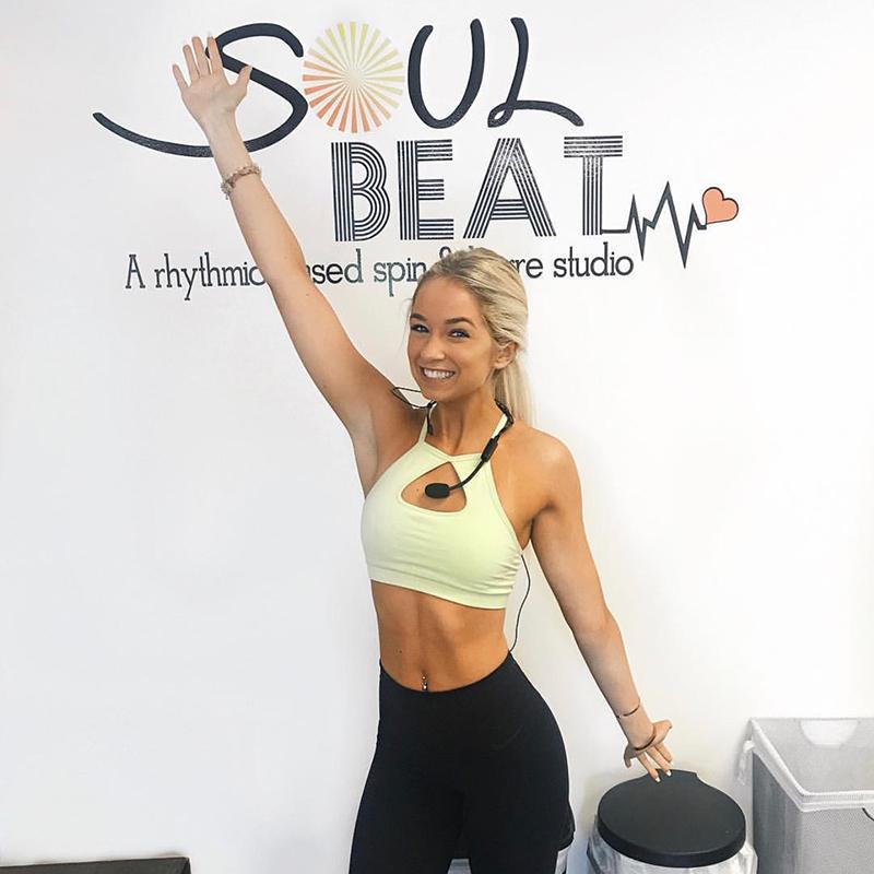 Tori Sterling poses in front of Soul Beat studio