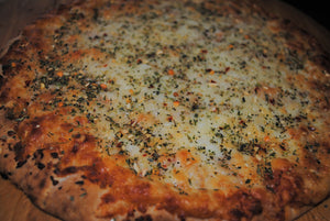 pizza with tuscany herbs and spice seasoning mix as pizza topping by unique flavors spice and herb company