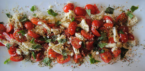 Tuscany Italian seasoning mix by unique flavors as topping on tomato mozzarella salad