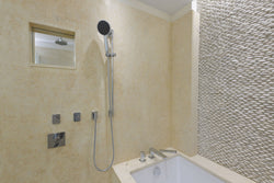 Pebble Wall in Bathroom | Antique Timor White