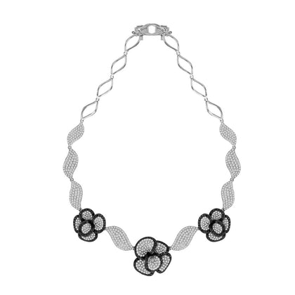white gold flower necklace with black and white diamonds