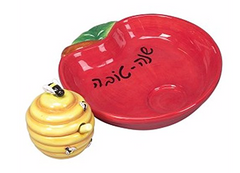 red apple dish with yellow bumble bee honey pot