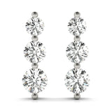 platinum three stone diamond earrings