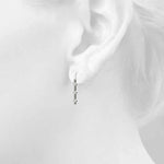 white gold three stone diamond drop earrings