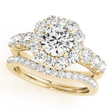 yellow gold halo diamond engagement ring and yellow gold diamond wedding band
