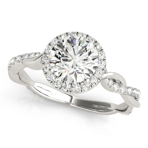 white gold round halo diamond engagement ring with a twisted shank